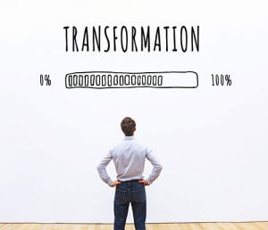man standing in from of transformation loading
