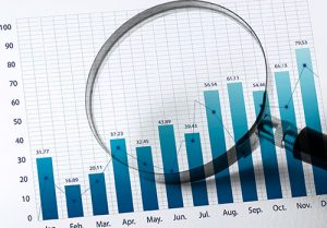 Magnifying glass and business growth graph(financial graph)